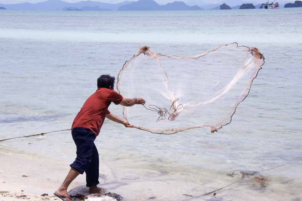 Asiaphotostock casting fishing net for Fish nets near me