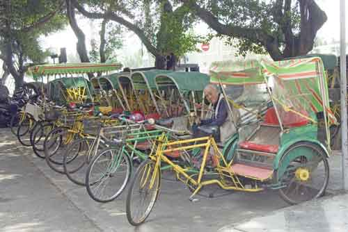 trishaws in macau-asia photo stock