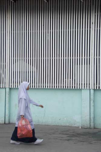 walk by mosque wall-asia photo stock