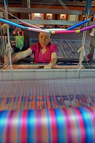 weaving in chiang mai-AsiaPhotoStock