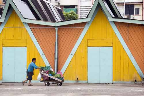 barrow by yellow wall-asia photo stock